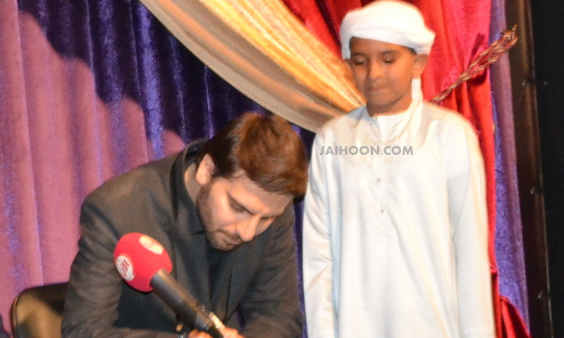 An emirati boy at the Sami Yusuf book signing