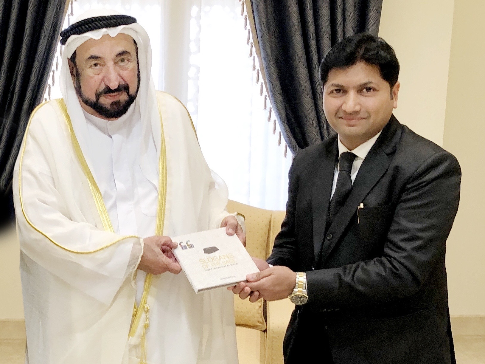 Mujeeb Jaihoon presents SLOGANS OF THE SAGE to Dr. Sheikh Sultan, ruler of Sharjah