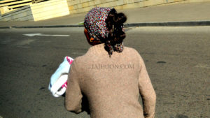 A beggar with her infant at Tbilisi streets