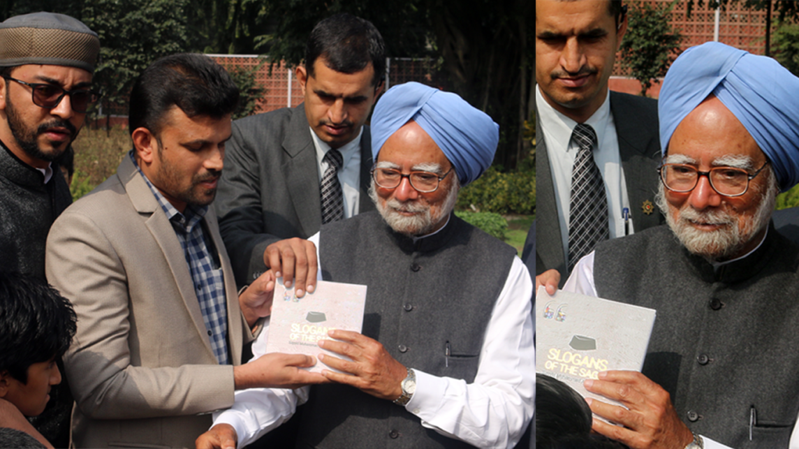 India's former Prime Minister, Dr. Manmohan Singh, being presented with SLOGANS OF THE SAGE, a coffee table book compiled by Mujeeb Jaihoon, which contains the philosophical aphorisms of late statesman and philanthropist, Sayyid Muhammad Ali Shihab Thangal.
