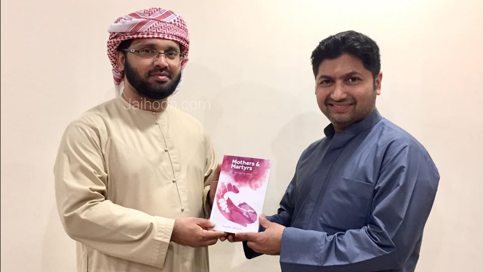 Presenting a copy of the book, Mothers & Martyrs, to prominent multilingual Islamic orator, Ustad Simsarul Haq Hudawi