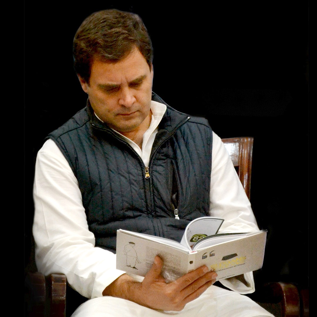 Rahul Gandhi, president of Indian National Congress, reading Slogans of the Sage, collection of aphorisms by Sayyid Shihab Thangal