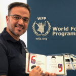 Wasim Samara, UN WFP, with the book, Slogans of the Sage